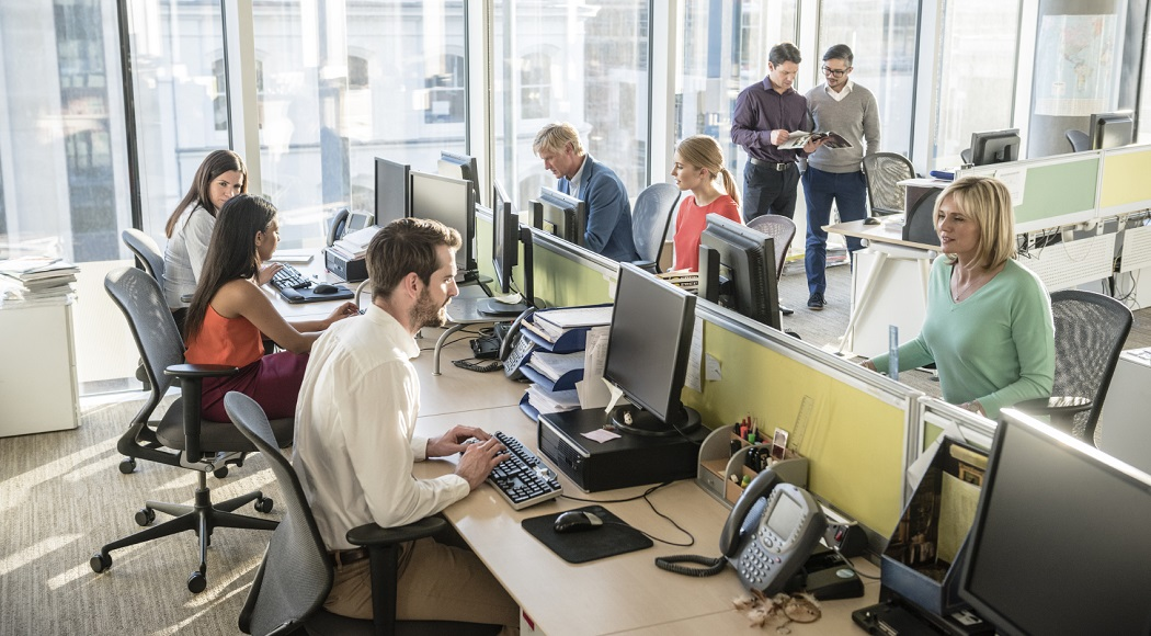 Call Center with colleagues consulting in the background